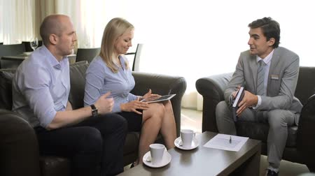 bank : Man consulting couple of clients