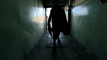 horror : Shaky camera approached by awful freak walking along corridor of derelict building in slow motion