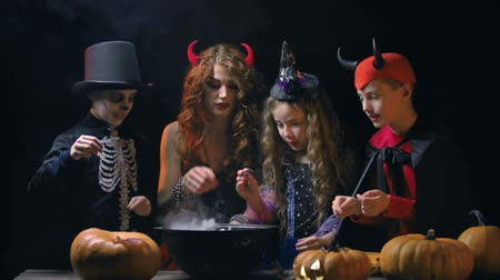 trik : Adult witch teaching next generation the craft of conjuring