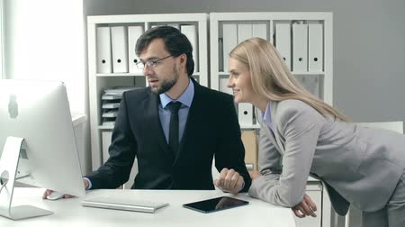 counsel : Two colleagues busy with informal discussion of something on the computer screen