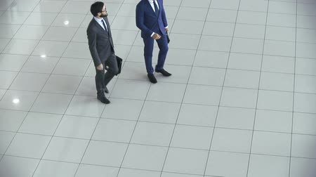 compromise : Right from above shot of two business people shaking hands