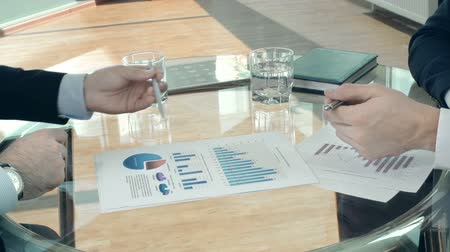 projects : Close up of documents compared by unrecognizable businessmen Stock Footage