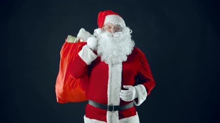 maci : Santa Claus with sack of gifts heaving with laughter Stock mozgókép