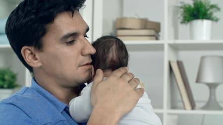 newborn child : Portrait of handsome father caressing baby boy