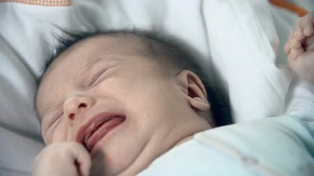just born : Frustrated just born child weeping in the cradle Stock Footage