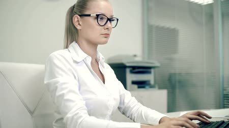 boss : Secretary bringing documents to female boss busy typing on computer