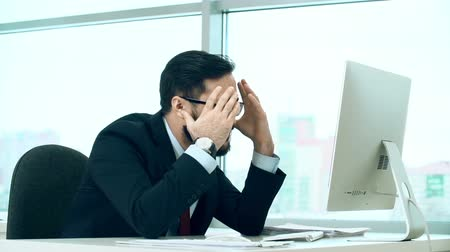 falido : Close up of businessman depressed by the news Stock Footage