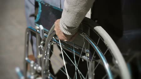 terapia : Tilt up of wheelchair details with cropped unrecognizable patient driving it Vídeos