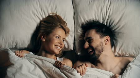 sheet : Sweet couple hiding under the sheets and laughing