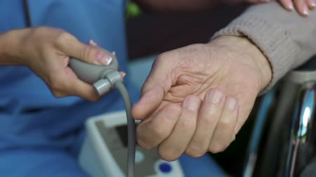 tıbbi bakım : Extreme close up of hand measuring pressure of another hand