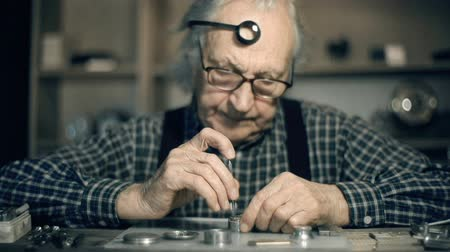 unscrewing : Dolly of watchmaker busy with his work