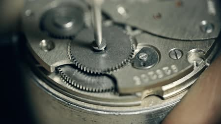 unscrewing : Extreme close up of watch wheel unscrewed and screwed back