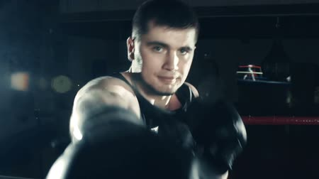 deslizamento : Shaky camera shot of boxer laying himself about looking straight at camera Vídeos