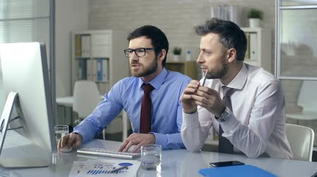 agreement : Close up of two coworkers busy discussing project