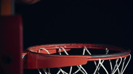 abroncs : Side view of basketball going right through the net