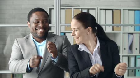 black : Close up of businessman and his female colleague dancing in the office