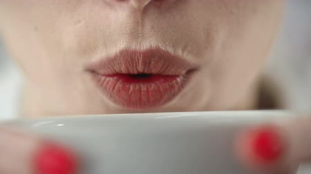 coffee brewing : Extreme close up of female mouth sipping from the cup of coffee Stock Footage