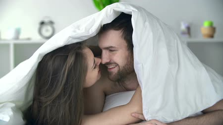 романтика : Close up of sweet couple cuddling in bed