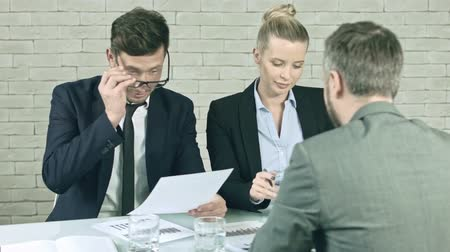 collaboration : Manager presenting a contract to his business partners Stock Footage