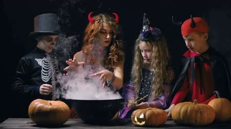 szatan : Devil woman teaching little evil characters to cook magic potion