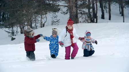 deep snow : Four kids walking in deep snow holding hands, one of them falling