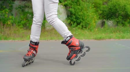 roller blading : Legs of a woman roller skating backwards and turning to forward in slow motion