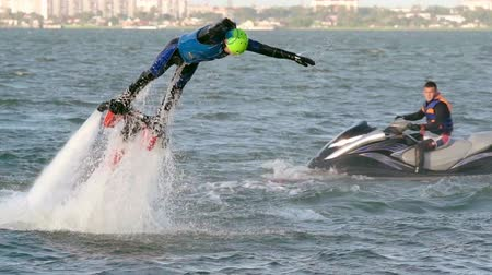 veículo aquático : Man jumping out of the water on flyboard attached to wavejammer