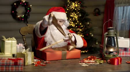 santa : Santa Claus packing diligently Christmas gifts