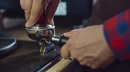 presleme : Closeup of barista pressing freshly ground coffee in portafilter with tamper, slow motion shot on Sony NEX 700 Stok Video