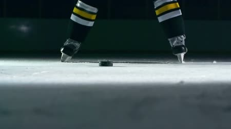 close up shot : Closeup of hockey player slapping a puck with his stick in slow motion Stock Footage