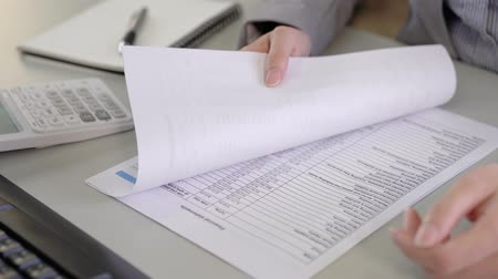 flip chart : business people flipping financial statements paper by hand Stock Footage