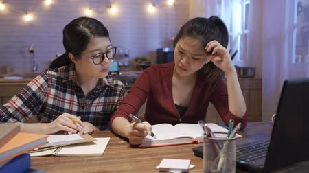 college girl in glasses help and consoling her exhausted woman friend who was defeated in studying project. female student support and comforting upset roommate during work troubles in night kitchen Wideo