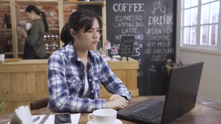 Angry girl freelance worker in street coffee shop sitting with modern laptop computer. Mobile office concept. mad office lady work on notebook pc with bad project while barista prepare order in cafe