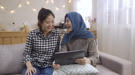 group of happy multi ethnic female waving hand talking on video chat using high speed internet for good connection on digital tablet device. Positive islam and chinese girls communicate with friend Dostupné videozáznamy