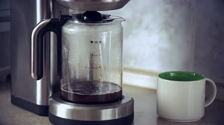 coffee time : Close-up shot of coffee brewing in coffee maker and flowing in to carafe Stock Footage