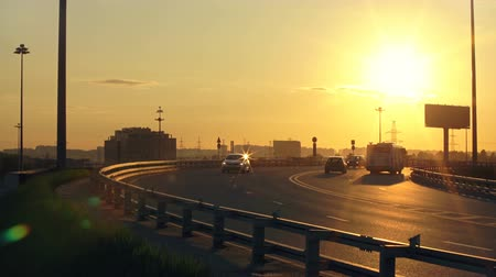 short clip : City Road With Active Traffic On Sunset Stock Footage