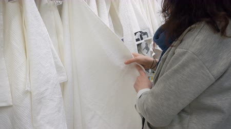 short clip : Woman Choosing White Honeycomb Towel In Department Store