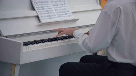 short clip : Professional Musician Playing White Piano