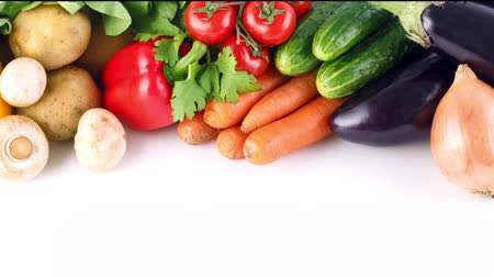 fresh food : Fresh vegetables closeup, carrot, pepper, potato. Organic and vegan food concept. Stock Footage