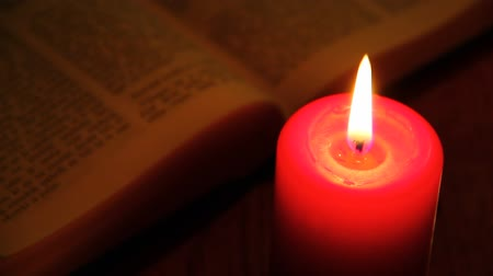kart : Red candle and old book.