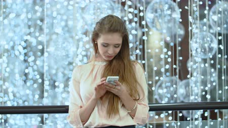 latino americana : Image of young female using cellular phone