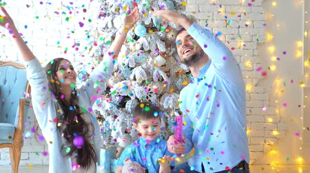 portre : Family have launched confetti on Christmas background Stok Video