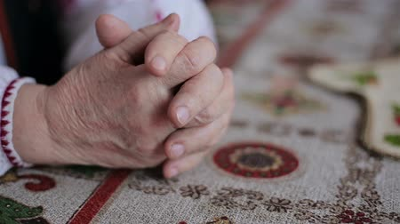 clergy : Hands of old woman Stock Footage