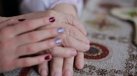 gentleness : Old and young hands. Clous-up