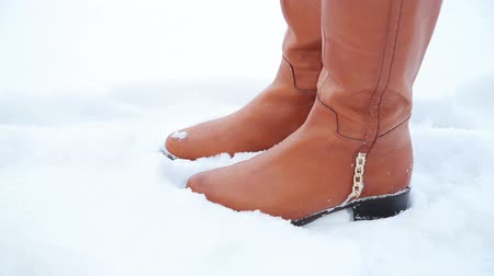 cipőfűző : Womens legs in the snow, cold Stock mozgókép