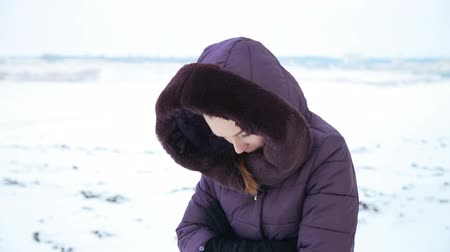 cold : Beautiful girl in her cold snowy field Stock Footage