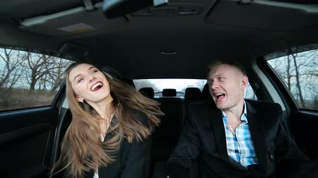success : Business woman and man dancing like crazy while driving car after success Stock Footage