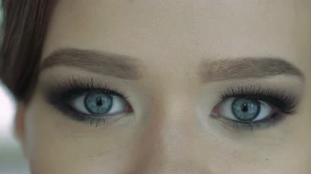 kaşları : Close up of young womans eyes. Slowly