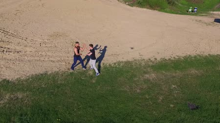 quimono : Aerial view of Wing Chun  on a coast between strong men Vídeos