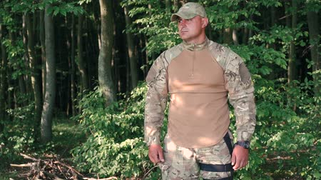 pain free : Portrait of young military in the forest Stock Footage